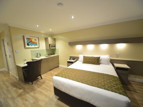 Deluxe room with kitchenette - Bentley Motel